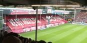 Die SC-Fans gaben ein deutliches Statement ab - und die Freiburger Mannschaft tat es ihnen nach. Foto: Bicker