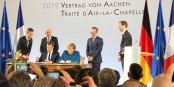 Angela Merkel ed Emmanuel Macron alla firma del Trattato di Aachen. Foto: (c) Patrick Hetzel